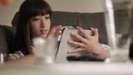 Tablet sofa woman C video