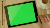 Tablet with Green Screen Laying on a Table video