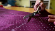 HD: Tailor Cutting A Piece Of Textile video