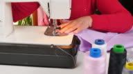 Tailor Sewing Clothes with her Sewing Machine video