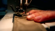 Tailor sewing on the sewing machine video