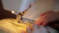 Tailor works on sewing machine video