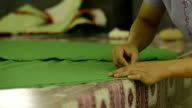 Tailoring Process-woman tailor standing and drawing on textile material video
