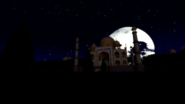 Taj Mahal at night against full moon, dolly shot video