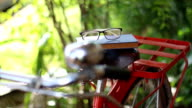 take book and glasses from the bike saddle video