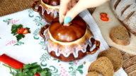 Take off the table the painted pot with vegetarian soup. video