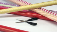 Take scissors from the table with wrapping paper video