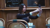 Taking a selfie at cafe (slow motion) video