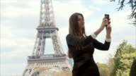 Taking a selfie with Eiffel Tower (slow motion) video
