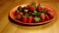 Taking a strawberry from plate video