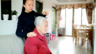 Taking care of senior woman combing video