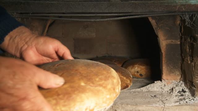 HD: Taking Fresh-Baked Bread From Brick Oven video