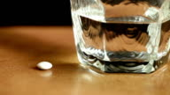Taking pain killer tablets or pills and drinking cup video