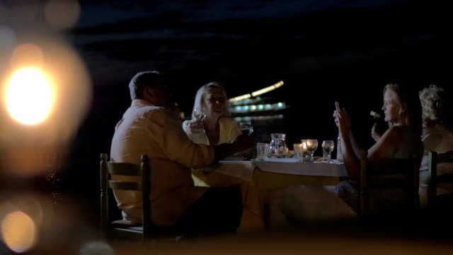 Taking photos during family dinner on the beach video