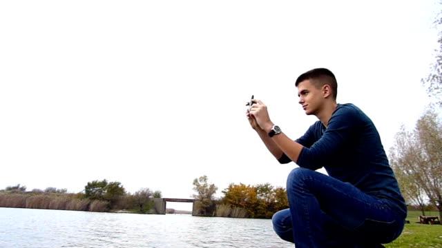 taking photos on lake shore video