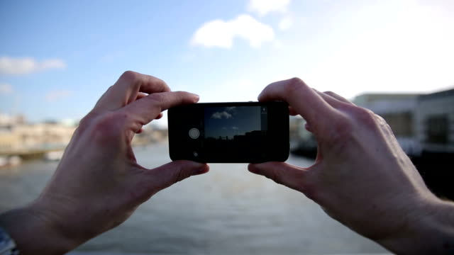 taking picture of tower bridge and river thames video