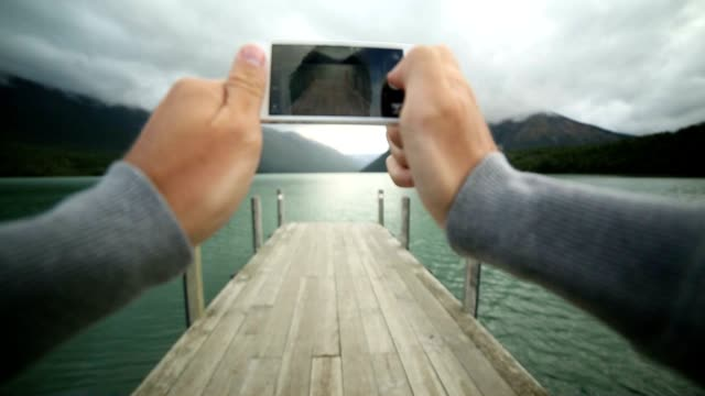 Taking pictures with a mobile phone. POV video