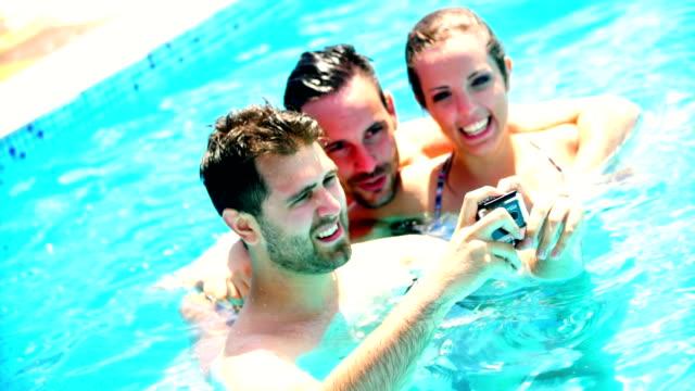 Taking selfies in swimming pool. video