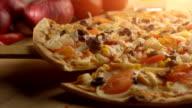 taking slice of vegetarian pizza video