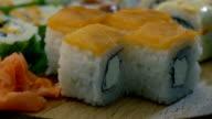 taking sushi rolls video