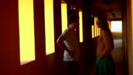 Talk in hotel corridor video