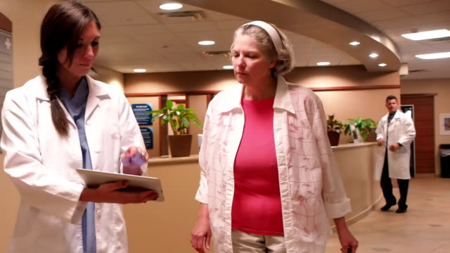 Talking With Patient In Hospital Lobby video
