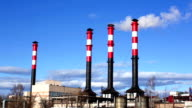 Tall chimneys in blue sky, air pollution video