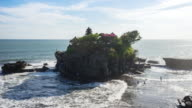 Tanah Lot is a rock formation off the Indonesian island of Bali video