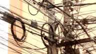 Tangle of telephone, electric and cable wires video