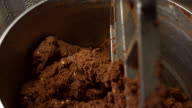 Tank filled with brown dough. video
