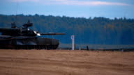 Tank T-90 at a high rate goes on the attack during a military exercise video