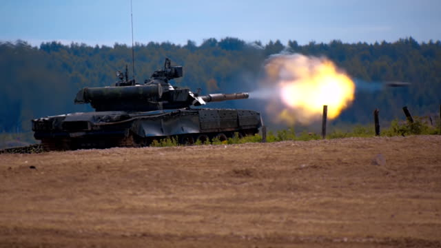 Tank T-90 is on the range and shoot at targets during military exercises video