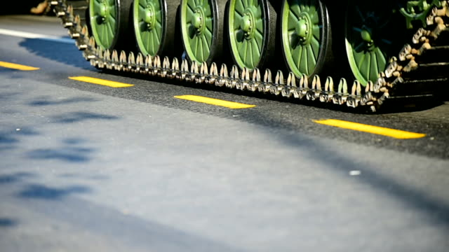 Tank tracks and wheels during military parade video