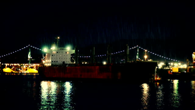 Tanker Ship Passing Bridge At Night video