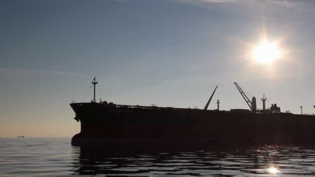 tankers silhouettes at sunset video
