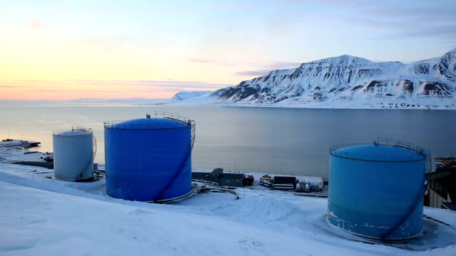 Tanks for the storage of oil. Storage facility on the shores of the Arctic Ocean video