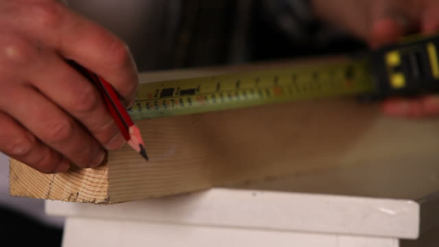 Tape measure with pencil on wood video