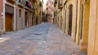 Tarragona street, Catalonia, Spain, establishing shot old town buildings video