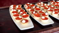 Tartlets Filled with Red Caviar and Cream Cheese on White Plates video