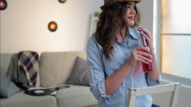 Tasteful red drink from bottle video