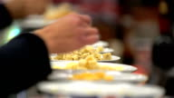 Tasting different varieties of cheese. Close-Up video