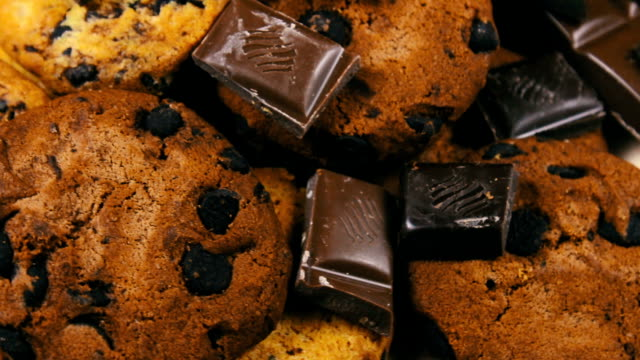 Tasty chip cake cookies with chocolate pieces shallow and Pieces of milk and dark chocolate video