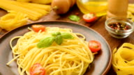 Tasty hot spaghetti with tomatoes and basil video