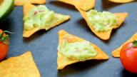 Tasty mexican guacamole on nachos video
