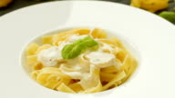 Tasty pasta with mushrooms, fresh basil and cream sauce video