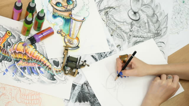 Tattoo-artist draws the sketches for tattoo video