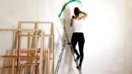 Tattooed Female Artist Painting WS video