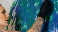 Tattooed Female Artist Painting CU video