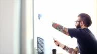 Tattooed hipster beard is having fun in the office video