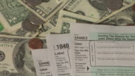 Tax forms and money video
